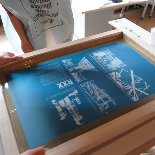 Demonstration of silk-screen set-up for printing.