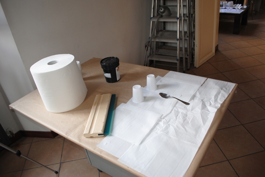 Workspace Basics: protective coverings, ink and tools handy.