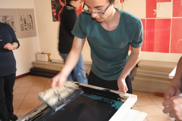 Student spreading ink